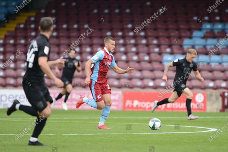 Bournemouth loanee Frank Vincent (23) of Scunthorpe United running with the ball during the EFL Cup match between Scunthorpe United and Port Vale at Glanford Park, Scunthorpe