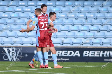Ryan Loft (9) Bournemouth loanee Frank Vincent (23) and George Hornshaw (44) of Scunthorpe United celebrates a goal (GOAL 1-1) during the EFL Cup match between Scunthorpe United and Port Vale at Glanford Park, Scunthorpe