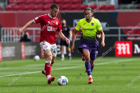 Bristol City's Tommy Rowe (25) under pressure from Exeter City's Randell Williams (11) during the EFL Cup match between Bristol City and Exeter City at Ashton Gate, Bristol