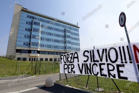 Stock Image of The banner that reads: 'Force Silvio!!! Monza is waiting for you to win together...', signed Curva Davide Pieri (a sector of the stadium where the AC Monza football team of which Paolo Berlusconi, brother of the former Italian Premier, is president), exhibited by AC Monza fans in front of one of the entrances to the San Raffaele hospital where Forza Italia leader Silvio Berlusconi is hospitalized infected by Covid-19, Milan, Italy, 05 September 2020.