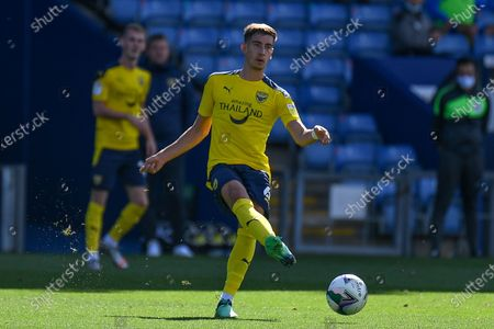 Oxford United midfielder Alex Rodriguez Gorrin(6) looks to release the ball during the EFL Cup match between Oxford United and AFC Wimbledon at the Kassam Stadium, Oxford