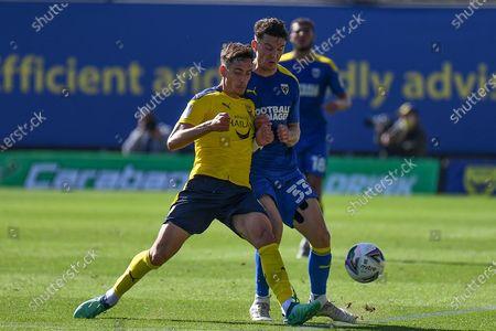 Oxford United midfielder Alex Rodriguez Gorrin(6) battles for possession  with AFC Wimbledon midfielder Callum Reilly (33) during the EFL Cup match between Oxford United and AFC Wimbledon at the Kassam Stadium, Oxford