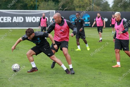 Soccer Aid World XI FC's Kem Cetinay is challenged by Mikael Silvestre during a training session in Manchester ahead of Soccer Aid for Unicef 2020.The match takes place on Sunday 6th September at Old Trafford, home of Manchester United. The match will be broadcast live and exclusive on ITV and STV 6:30pm.