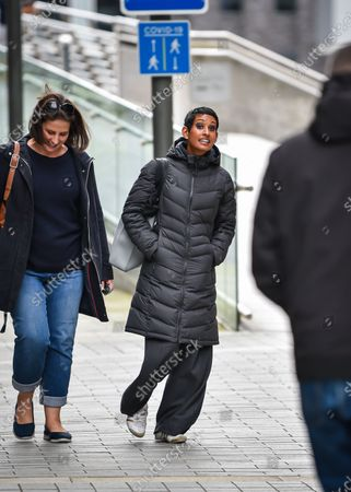 Stock Photo of BBC presenter, Naga Munchetty, avoids Extinction Rebellion protestors that gathered outside the BBC at Salford Quays today, to highlight what they regard as a the lack of media coverage