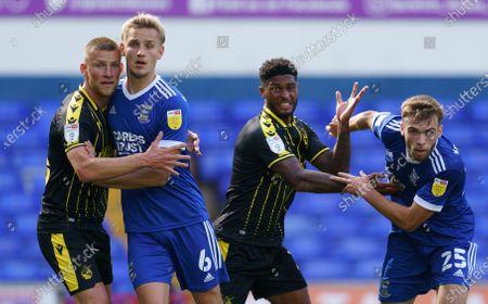 Alfie Kilgour of Bristol Rovers holds Luke Woolfenden of Ipswich Town as Aaron Drinan of Ipswich Town moves past Mark Little of Bristol Rovers