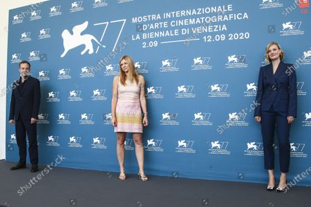Director Susanna Nicchiarelli poses for photographers with actors Patrick Kennedy, left, and Romola Garai at the photo call for the film 'Miss Marx' during the 77th edition of the Venice Film Festival in Venice, Italy