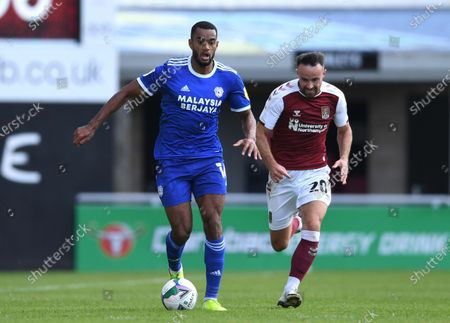 Stock Photo of Curtis Nelson of Cardiff City gets away from Matt Warburton of Northampton Town.