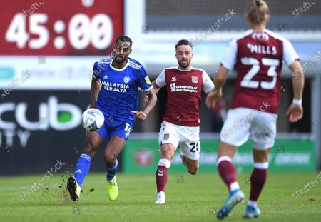 Stock Picture of Curtis Nelson of Cardiff City gets away from Matt Warburton of Northampton Town.