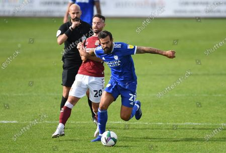 Marlon Pack of Cardiff City is tackled by Matt Warburton of Northampton Town.