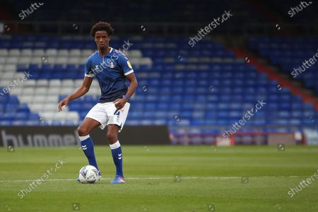 Oldham's Sido Jombati (4) looks to make a pass  during the EFL Cup match between Oldham Athletic and Carlisle United at Boundary Park, Oldham