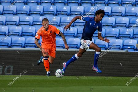 Lewis Alessandra (9) of Carlisle takes on Sido Jombati (4) of Oldham  during the EFL Cup match between Oldham Athletic and Carlisle United at Boundary Park, Oldham