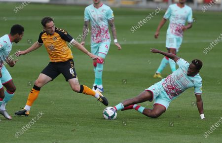 Matthew Dolan of Newport County is tackled by Jamal Lowe of Swansea City.