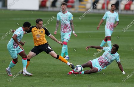 Stock Photo of Matthew Dolan of Newport County is tackled by Jamal Lowe of Swansea City.