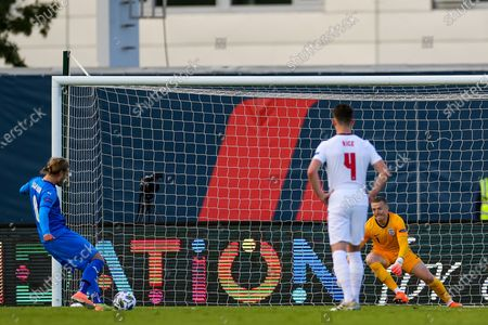 England goalkeeper Jordan Pickford (1) prepares to save the penalty from Iceland midfielder Birkir Bjarnason (8) during the UEFA Nations League match between Iceland and England at Laugardalsvollur, Reykjavik