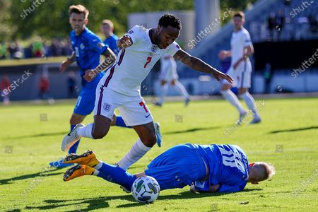 England midfielder Raheem Sterling (7) is tackled by Iceland defender Hordur Magnusson (18) during the UEFA Nations League match between Iceland and England at Laugardalsvollur, Reykjavik