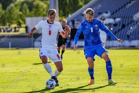 England midfielder James Ward-Prowse (8) holds off Iceland midfielder Birkir Bjarnason (8 ) during the UEFA Nations League match between Iceland and England at Laugardalsvollur, Reykjavik