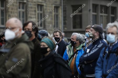 """Stock Image of People, wearing face masks to protect against the coronavirus as they line up to attend a 'chord change' of the organ of the John Cage organ project at the partially ruined Burchardi Church in Halberstadt, Germany, . The performance of the """"ORGAN/ASLSP,"""" or As Slow As Possible, composition by John Cage began in September 2001 at the church in the eastern town of Halberstadt and is supposed to end in 2640. The last chord change was in 2013"""