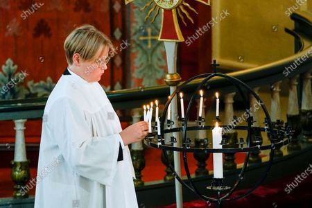 Stock Picture of Norwegian Prince Sverre Magnus lights a candle during his confirmation at the Asker Church, in Asker, Norway, 05 September 2020.