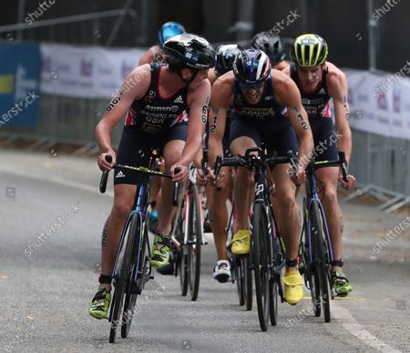 Alistair Brownlee (L) of Great Britian competes in the cycling portion of the Men's Elite race at the Hamburg Wasser World Triathlon event in Hamburg, northern Germany, 05 September 2020.