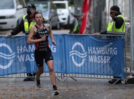 Georgia Taylor-Brown from Great Britain competes in the running portion of the Women's Elite race at the Hamburg Wasser World Triathlon event in Hamburg, northern Germany, 05 September 2020.