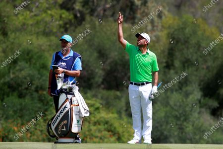 Spanish golfer Pablo Larrazabal (R) checks the direction of the wind during the third round of Andalusias' Pro-Am Golf Masters tournament at Valderrama golf course in Sotogrande town, Cadiz, southern Spain, 05 September 2020.