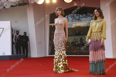 Actress Maya Hawke, left, and director Gia Coppola pose for photographers upon arrival at the premiere for the film 'Mainstream' during the 77th edition of the Venice Film Festival in Venice, Italy