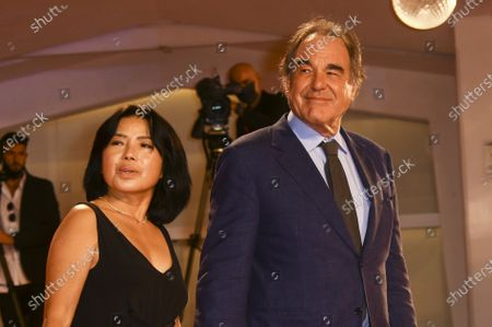 Director Oliver Stone, right, and Sun-jung Jung pose for photographers upon arrival at the un-jung Jung premiere of the film 'Miss Marx' during the 77th edition of the Venice Film Festival in Venice, Italy