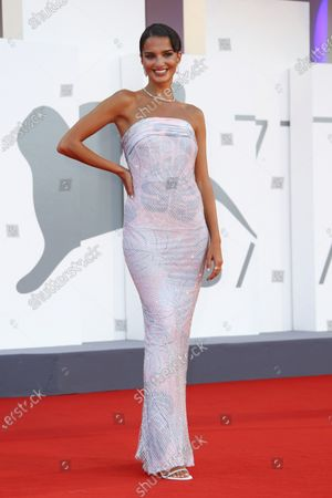 Model Gabrielle Caunesil poses for photographers upon arrival at the premiere of the film 'Miss Marx' during the 77th edition of the Venice Film Festival in Venice, Italy