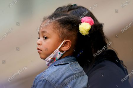 Three-year-old Alexis Olympia Ohanian Jr., daughter of Serena Williams, of the United States, watches her mother play against Sloane Stephens, of the United States, during the third round of the US Open tennis championships, in New York