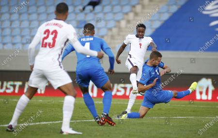 Iceland's Sverrir Ingason blocks a shot from England's Raheem Sterling and is adjudged to have handled the ball from which a penalty was awarded and he was given a red card during the UEFA Nations League soccer match between Iceland and England in Reykjavik, Iceland