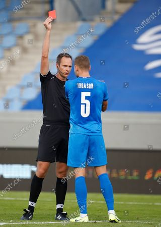 Iceland's Sverrir Ingason gets a red card from referee Srdjan Jovanovic after giving away a penalty during the UEFA Nations League soccer match between Iceland and England in Reykjavik, Iceland
