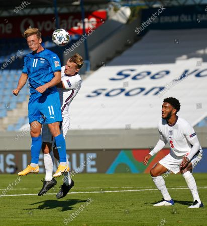 Iceland's Johann Berg Gudmundsson beats England's James Ward-Prowse to the ball as Joe Gomez looks on during the UEFA Nations League soccer match between Iceland and England in Reykjavik, Iceland