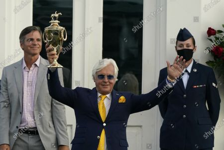 Trainer Bob Baffert holds the trophy after John Velazquez rode Authentic to victory in the 146th running of the Kentucky Derby at Churchill Downs, in Louisville, Ky