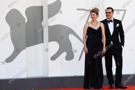 Hungarian screenwriter Kata Weber (L) and Hungarian film director Kornel Mundruczo arrive for the premiere of 'Pieces of a Woman' during the 77th annual Venice International Film Festival, in Venice, Italy, 05 September 2020. The movie is presented in the official competition 'Venezia 77' at the festival running from 02 to 12 September. The event is the first major in-person film fest to be held in the wake of the Covid-19 coronavirus pandemic. Attendees have to follow strict safety measures like mandatory face masks indoors, temperature scanners, and socially distanced screenings to reduce the risk of infection. The public is barred from the red carpet, and big stars are expected to be largely absent this year.