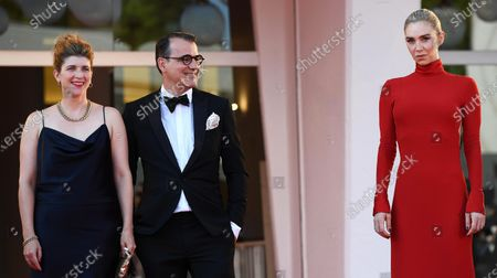 Hungarian screenwriter Kata Weber (L), Hungarian film director Kornel Mundruczo (C) and British actress Vanessa Kirby (R) arrive for the premiere of 'Pieces of a Woman' during the 77th annual Venice International Film Festival, in Venice, Italy, 05 September 2020. The movie is presented in the official competition 'Venezia 77' at the festival running from 02 to 12 September. The event is the first major in-person film fest to be held in the wake of the Covid-19 coronavirus pandemic. Attendees have to follow strict safety measures like mandatory face masks indoors, temperature scanners, and socially distanced screenings to reduce the risk of infection. The public is barred from the red carpet, and big stars are expected to be largely absent this year.