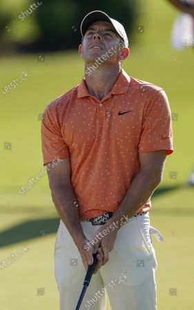 Rory McIlroy reacts after missing a putt for par on the 18th hole during the second round of the Tour Championship golf tournament at East Lake Golf Club in Atlanta
