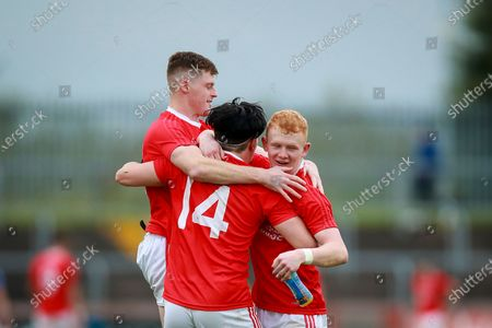 Stock Picture of Trillick vs Coalisland. Trillick's Simon Garrity celebrates at the final whistle with Lee Brennan and Darragh McQuaid