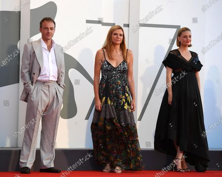 Susanna Nicchiarelli (C) and British actors Romola Garai (R) and Patrick Kennedy (L) arrive for the premiere of 'Miss Marx' during the 77th annual Venice International Film Festival, in Venice, Italy, 05 September 2020. The movie is presented in the official competition 'Venezia 77' at the festival running from 02 to 12 September. The event is the first major in-person film fest to be held in the wake of the Covid-19 coronavirus pandemic. Attendees have to follow strict safety measures like mandatory face masks indoors, temperature scanners, and socially distanced screenings to reduce the risk of infection. The public is barred from the red carpet, and big stars are expected to be largely absent this year. The 77th edition of the festival runs from 02 to 12 September 2020.