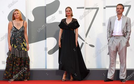 Susanna Nicchiarelli (L) and British actors Romola Garai (C) and Patrick Kennedy (R) arrive for the premiere of 'Miss Marx' during the 77th annual Venice International Film Festival, in Venice, Italy, 05 September 2020. The movie is presented in the official competition 'Venezia 77' at the festival running from 02 to 12 September. The event is the first major in-person film fest to be held in the wake of the Covid-19 coronavirus pandemic. Attendees have to follow strict safety measures like mandatory face masks indoors, temperature scanners, and socially distanced screenings to reduce the risk of infection. The public is barred from the red carpet, and big stars are expected to be largely absent this year. The 77th edition of the festival runs from 02 to 12 September 2020.