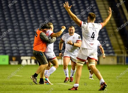 Edinburgh vs Ulster. Ulster's Alan O'Connor and Jack McGrath celebrate with Ian Madgidan after he converts a last minute penalty to win the game