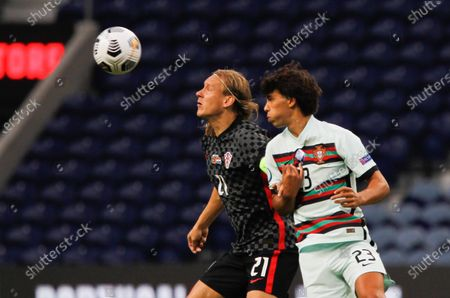 Domagoj Vida of Croatia in action with Joao Felix of Portugal during the UEFA Nations League Group A3 match between Portugal and Croatia at the Estadio do Dragao, Porto