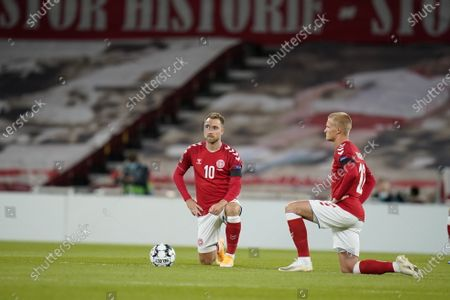 Christian Eriksen and Kasper Dolberg of Denmark take a knee to support the Black Lives Matters movement before the UEFA Nations League group stage soccer match between Denmark and Belgium in Copenhagen, Denmark, 05 September 2020.