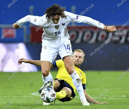 France's Adrien Rabiot in action against  Sweden's Sebastian Larsson (down) during the  UEFA Nations League soccer match between Sweden and France at Friends Arena in Stockholm, Sweden, 05 September 2020.