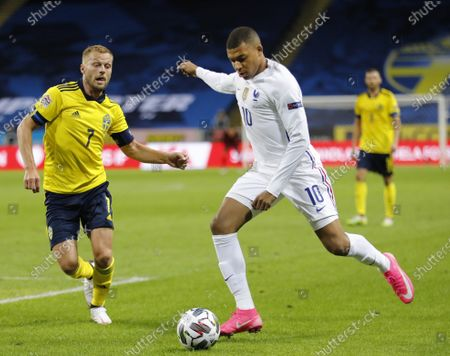 France's Kylian Mbappe (R) scores the opening goal next to Sweden's Sebastian Larsson during the UEFA Nations League soccer match between Sweden and France at Friends Arena in Stockholm, Sweden, 05 September 2020.