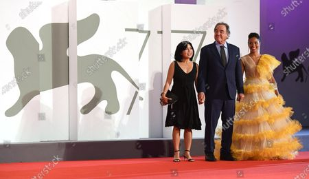 Oliver Stone (C), his wife Sun-jung Jung (L) and guest attend the Kineo Diamanti Award Ceremony during the 77th annual Venice International Film Festival, in Venice, Italy, 05 September 2020. The event is the first major in-person film fest to be held in the wake of the Covid-19 coronavirus pandemic. Attendees have to follow strict safety measures like mandatory face masks indoors, temperature scanners, and socially distanced screenings to reduce the risk of infection. The public is barred from the red carpet, and big stars are expected to be largely absent this year. The 77th edition of the festival runs from 02 to 12 September 2020.