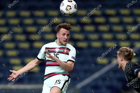 Portugal's Diogo Jota heads the ball in front of Croatia's Tin Jedvaj during the UEFA Nations League soccer match between Portugal and Croatia at the Dragao stadium in Porto, Portugal