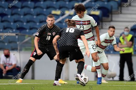 Portugal's Joao Felix challenges Croatia's Tin Jedvaj, back to camera during the UEFA Nations League soccer match between Portugal and Croatia at the Dragao stadium in Porto, Portugal