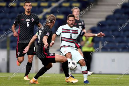 Portugal's Joao Moutinho, right, vies for the ball with Croatia's Domagoj Vida during the UEFA Nations League soccer match between Portugal and Croatia at the Dragao stadium in Porto, Portugal