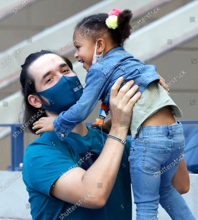 Serena Williams' daughter Alexis (R) is handed to her father Internet entrepreneur Alexis Ohanian (L) at the conclusion of the Serena Williams of the US verses Sloane Stephens of the US match on the sixth day of the US Open Tennis Championships the USTA National Tennis Center in Flushing Meadows, New York, USA, 05 September 2020. Due to the coronavirus pandemic, the US Open is being played without fans and runs from 31 August through 13 September.