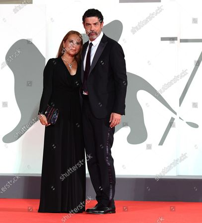Alessandro Gassmann (R) and his wife Sabrina Knaflitz arrive for the premiere of 'Non Odiare' during the 77th annual Venice International Film Festival, in Venice, Italy, 05 September 2020. The movie is presented in the official competition 'Venezia 77' at the festival running from 02 September to 12 September. The event is the first major in-person film fest to be held in the wake of the Covid-19 coronavirus pandemic. Attendees have to follow strict safety measures like mandatory face masks indoors, temperature scanners, and socially distanced screenings to reduce the risk of infection. The public is barred from the red carpet, and big stars are expected to be largely absent this year.